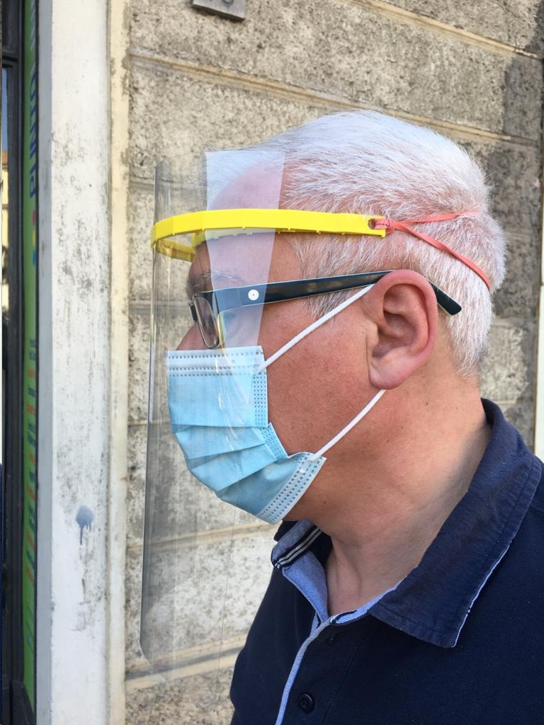 A Robots Everywhere designed face shield being worn in Verbania, Italy