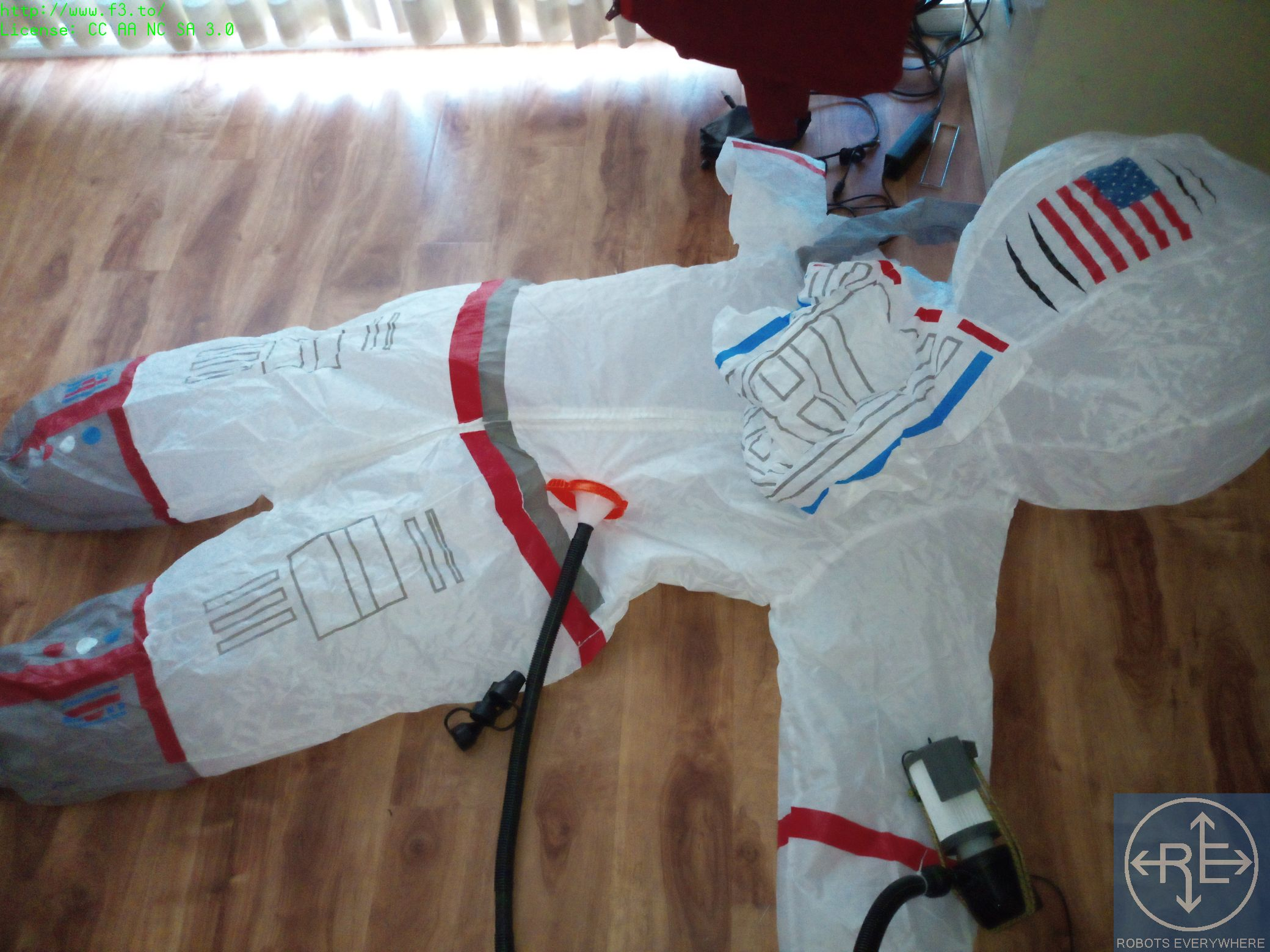 An inflatable astronaut costume converted into a PAPR suit for respiratory protection